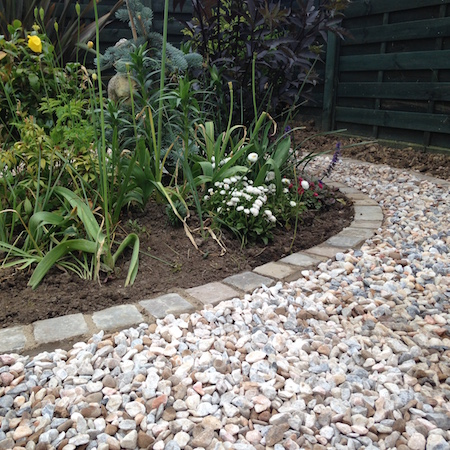 Limestone setts and flamingo gravel path