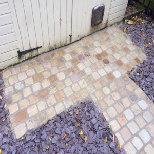 Small patio in sandstone cobbles
