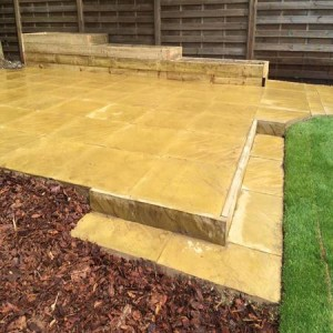 Edging a patio to cope with a slope