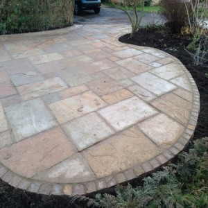 Sandstone patio edged with stone setts
