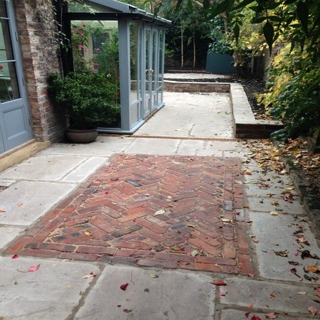 Create a feature in sandstone paving