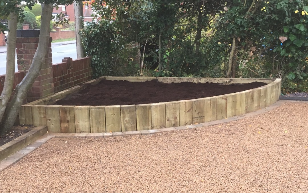 Gravel drive and corner bed